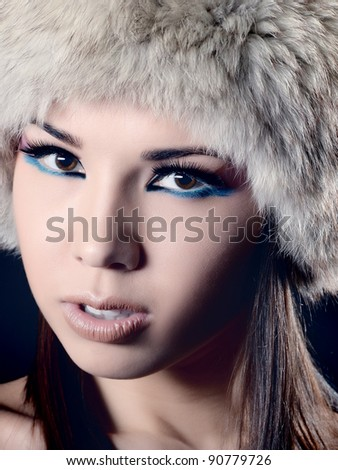 Beautiful Young Woman wearing Fur Hat.Winter Style - stock photo