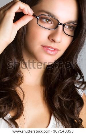 Beautiful young woman wearing glasses - stock photo