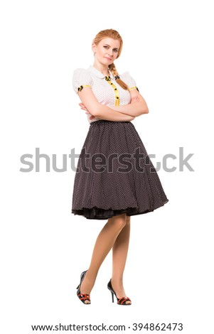 Beautiful young woman wearing retro dress. Isolated on white - stock photo