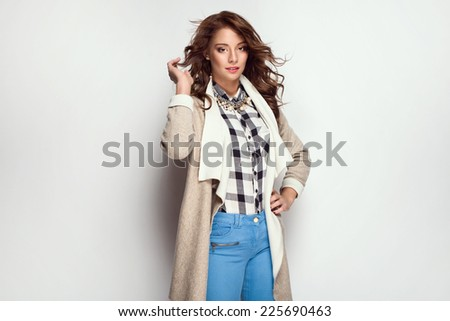 Beautiful young woman wearing warm cardigan  - stock photo