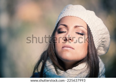 Beautiful young woman wearing white wool hat autumn portrait.  - stock photo