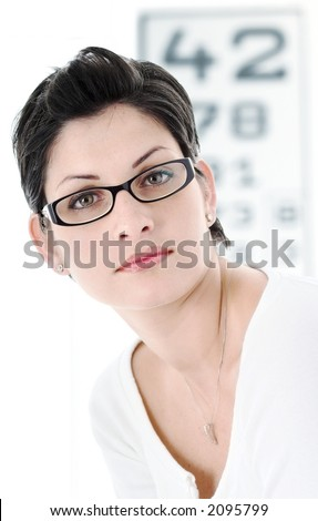 Beautiful young woman wears trendy glasses. - stock photo