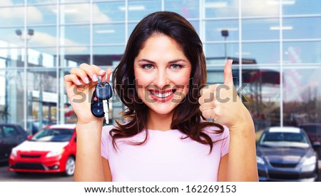 Beautiful young woman with a car keys. - stock photo