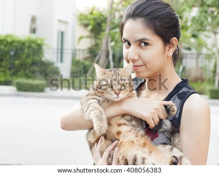 beautiful young woman with a cat - stock photo