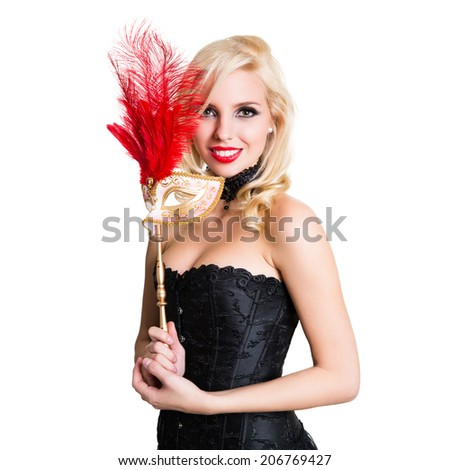 beautiful young woman with a golden mask - stock photo
