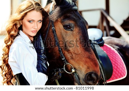 Beautiful young woman with a horse outdoor. - stock photo