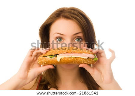 beautiful young woman with a hot-dog isolated against white background - stock photo