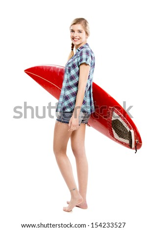 Beautiful young woman with a surfboard, over a gray background - stock photo