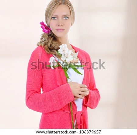 beautiful young woman with a white lily in her hands - stock photo