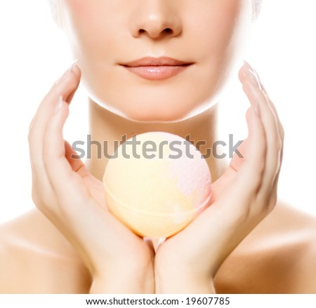 Beautiful young woman with aroma soap - stock photo