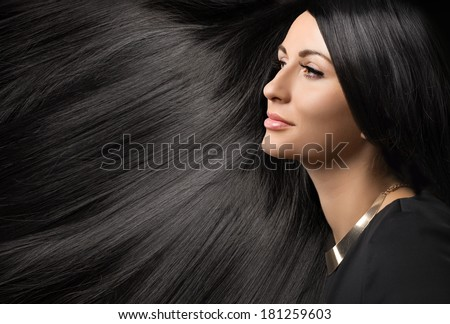 beautiful young woman with black shiny hair - stock photo