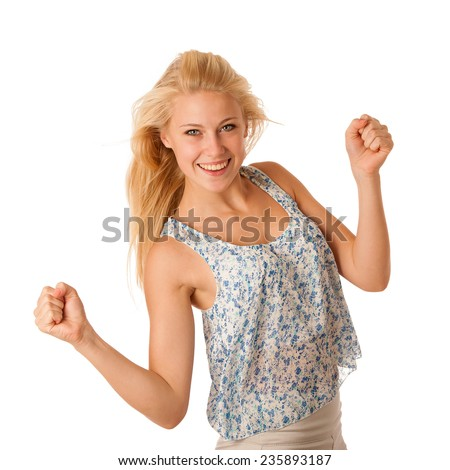 Beautiful young woman with blonde hair and blue eyes gestures success with holding her fists in the air isolated - stock photo