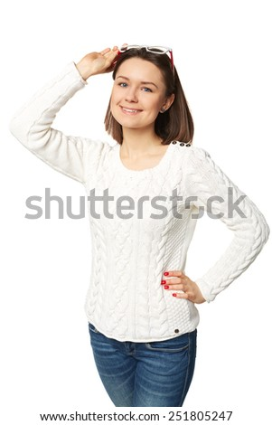 Beautiful young woman with blue eyes looking into the camera with her glasses balanced on top of her head isolated  - stock photo