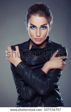beautiful young woman with bright make-up and leather jacket - stock photo