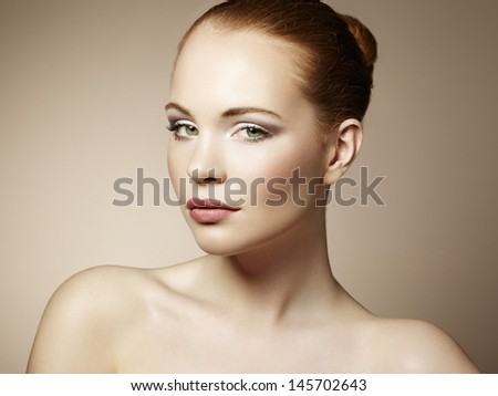 Beautiful young woman with bright make-up. Beauty fashion - stock photo