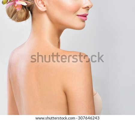 Beautiful young woman with clean fresh skin. - stock photo
