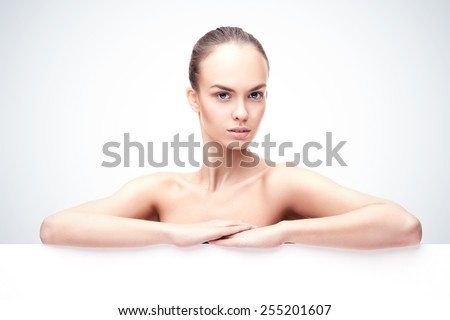 Beautiful young woman with clean fresh skin and copyspase - stock photo