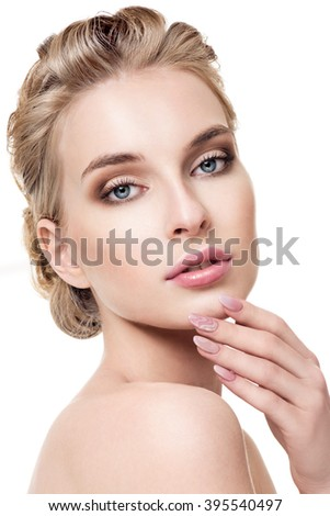 Beautiful Young Woman with Clean Fresh Skin. Close up Portrait.  Fashion Model Girl Face. Perfect Skin. Professional Makeup. Perfect manicure. - stock photo