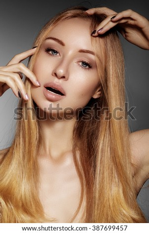 Beautiful young woman with clean skin, beautiful straight shiny hair, fashion makeup. Glamour make-up, perfect shape eyebrows. Portrait sexy blondy. Beautiful smooth hairstyle  - stock photo