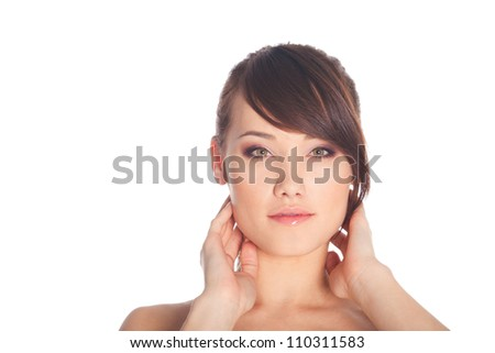 Beautiful young woman with clean skin posing on white background - stock photo
