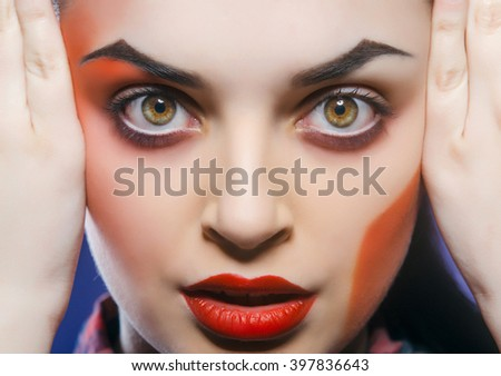 Beautiful young woman with color art makeup. - stock photo