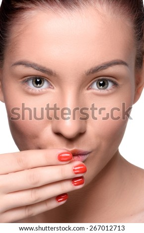 Beautiful young woman with colorful lips makeup and red nails looking at the camera. Close up head shot - stock photo