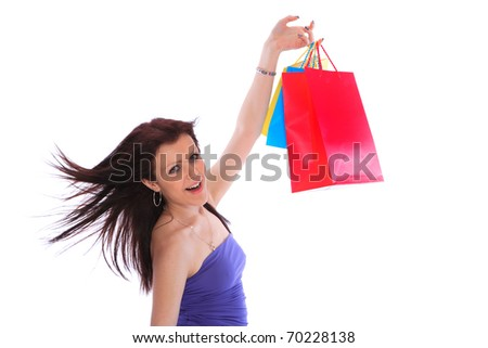 Beautiful, young, woman with colorful shopping bags in her hand - stock photo
