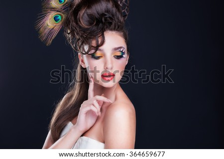 Beautiful young woman with creative fashion hairstyle. Spanish flamenco hairstyle.Creative makeup - stock photo