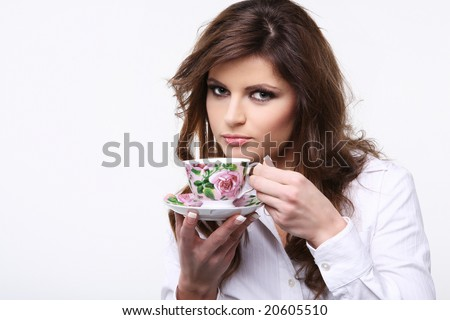 Beautiful young woman with cup of tea. - stock photo