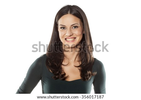 beautiful young woman with fake smile - stock photo