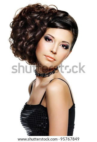 Beautiful young woman with fashion hairstyle and glamour makeup - on white background - stock photo