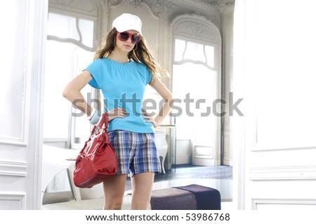 beautiful young woman with fashion sunglasses and handbag - stock photo