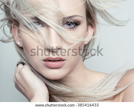 beautiful young woman with flawless skin and perfect make-up - stock photo