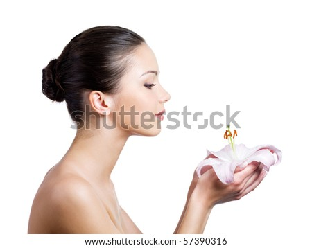 Beautiful young woman with flower in profile - isolated on white background - stock photo