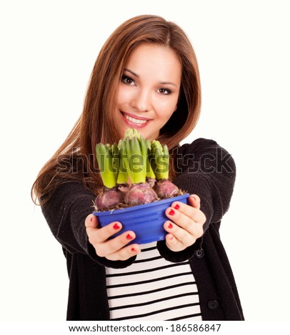beautiful young woman with flowers in pot, white background - stock photo