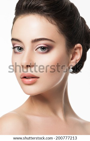 Beautiful young woman with fresh  bridal makeup and hairstyle. Classic wedding bridal look - stock photo
