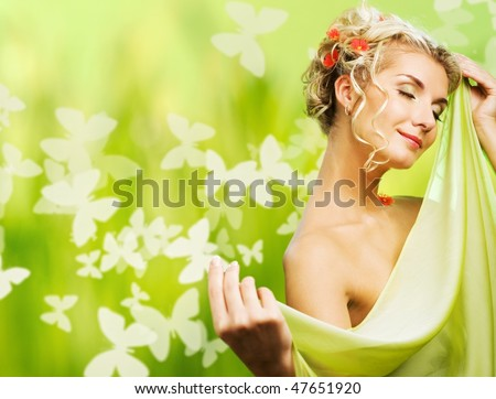 Beautiful young woman with fresh flowers in her hair. Spring concept. - stock photo