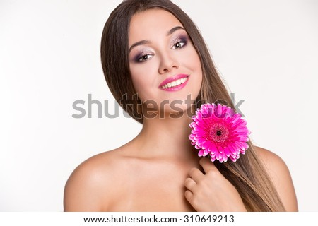 Beautiful young woman with gerbera - stock photo
