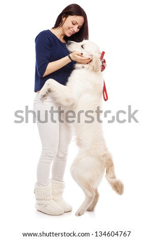 Beautiful young woman with golden retriever - stock photo