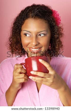 Beautiful young woman with great skin drinking her cup of morning coffee - stock photo