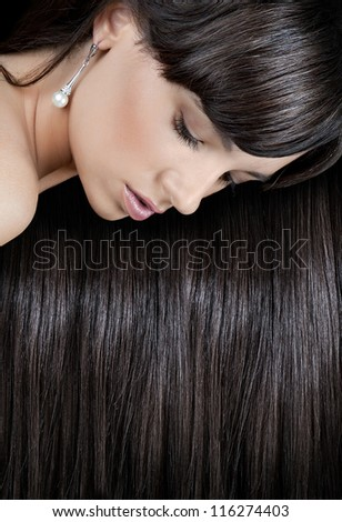beautiful young woman with healthy elegant long shiny hair - stock photo
