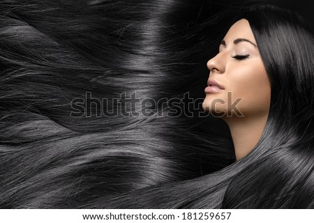 beautiful young woman with healthy long shiny hair - stock photo