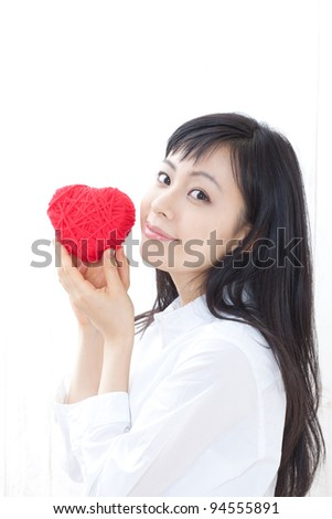 Beautiful young woman with heart symbol - stock photo
