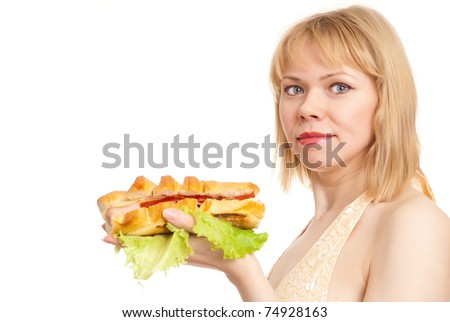 beautiful young woman with hot dog on a white background - stock photo