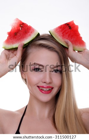 Beautiful young woman with juicy watermelon over white background - stock photo