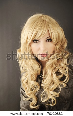 Beautiful young woman with long blond hair - stock photo