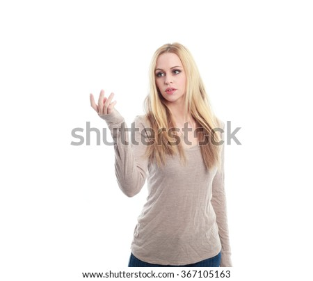 beautiful young woman with long blonde hair wearing a long sleeved cream shirt and gold necklace. hand reaching out to touch. isolated on white background. - stock photo