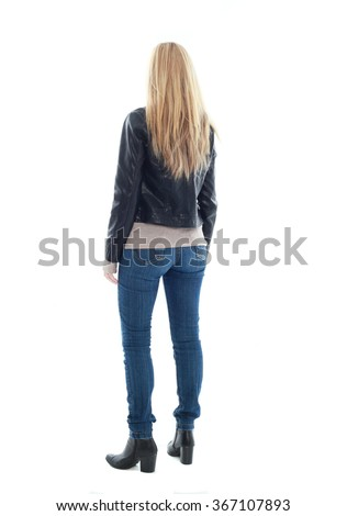 beautiful young woman with long blonde hair wearing black leather jacket and blue jeans.  standing pose, isolated on white background. - stock photo