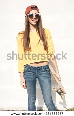 Beautiful young woman  with  long board in the afternoon. Skateboarding. Outdoors, lifestyle - stock photo