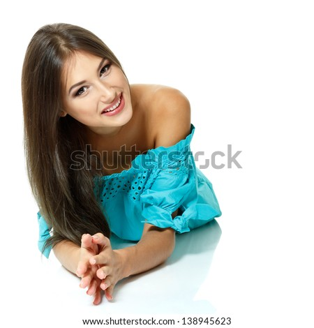 Beautiful young woman with long brown hair and in blue dress. Isolated on white background - stock photo